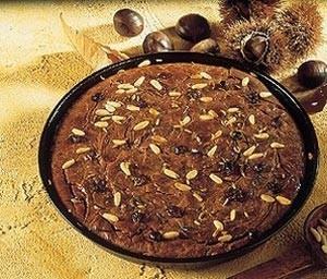 castagnaccio al cioccolato,castagnaccio,cioccolato,pinoli,uvetta,
